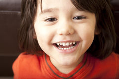 Happy Toddler Boy. A cute, bi-racial boy smiling and looking at camera Stock Image