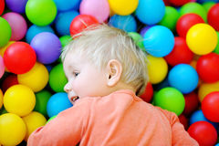 Happy toddler boy in ball pit Stock Images