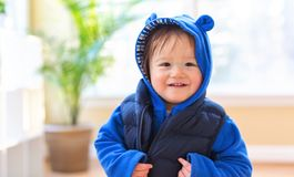 Happy toddler boy bundled up in winter clothes. Ready to go outside royalty free stock images