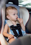 Happy toddler boy in car Royalty Free Stock Photo