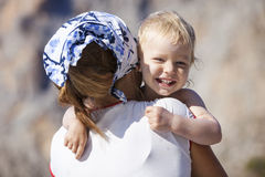 Happy toddler boy embracing mother. And laughing royalty free stock photography
