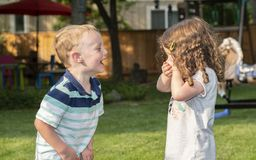 Happy Toddler Boy & Girl Laughing, Holding Hands and Playing royalty free stock images