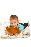 Happy toddler boy lying down Royalty Free Stock Photography