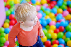 Happy toddler boy playing in ball pit Royalty Free Stock Photo