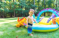 Toddler boy playing outside Stock Photo