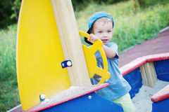 Happy toddler boy playing Royalty Free Stock Photo