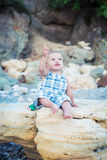 Happy toddler boy shows finger up Royalty Free Stock Photo