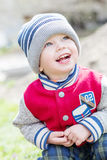 Happy Toddler boy sitting on his haunches Royalty Free Stock Image