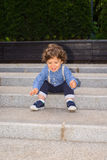 Happy toddler boy on stairs Royalty Free Stock Image