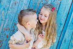 Happy Toddler brother and sister hugging stock images