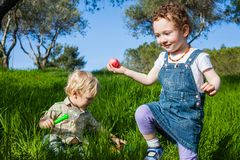 Happy toddler caught an egg for Easter Hunt Royalty Free Stock Photography