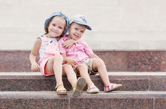 Happy toddler children sit on the steps Royalty Free Stock Photography