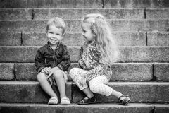 Happy toddler children sit on the steps Royalty Free Stock Images
