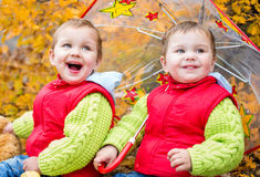 Happy toddler children under an umbrella Royalty Free Stock Image