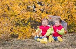 Happy toddler children under an umbrella Stock Photo