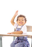Happy toddler at desk Royalty Free Stock Image
