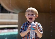 Happy toddler drinking water Royalty Free Stock Image