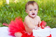 Happy toddler eating birthday cake Stock Photos