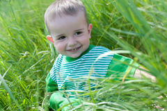 Happy toddler in the field Royalty Free Stock Photo