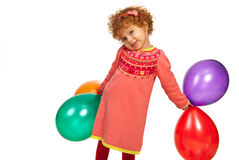 Happy toddler girl with balloons Royalty Free Stock Images