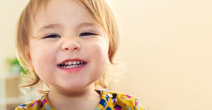 Happy toddler girl with a big beautiful smile Stock Photo