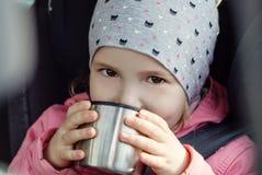 Happy Toddler girl in the car Stock Photo