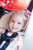 Happy toddler girl in car seat Royalty Free Stock Photos