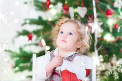Happy toddler girl checking her Christmas stocking Stock Photography