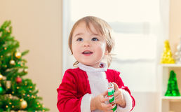 Happy toddler girl in front of her Christmas tree Royalty Free Stock Photography