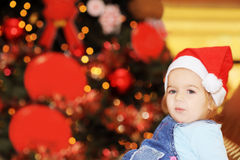 Happy toddler girl in front of xmas tree stock photos