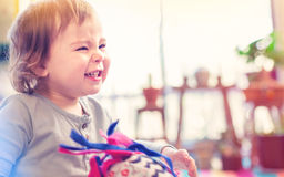 Happy toddler girl with a giant smile Stock Photo