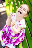 Happy toddler girl has a fun and laughing at beautiful spring park. At sunny day Royalty Free Stock Photography