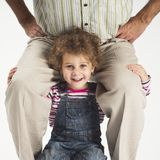 Happy toddler girl holding father on shoulders Royalty Free Stock Photo