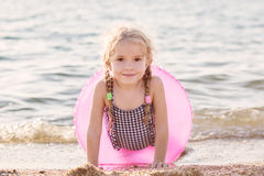 Happy Toddler girl with inflatable circle Stock Images
