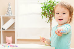 Happy toddler girl playing with chalk Stock Image
