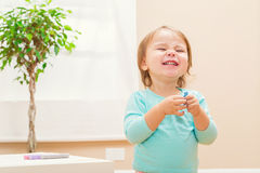 Happy toddler girl playing with chalk Royalty Free Stock Photos