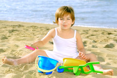 Happy toddler girl playing with her toys at beach Royalty Free Stock Photography