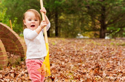 Happy Toddler girl playing outside in autumn Royalty Free Stock Image