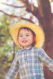 Happy toddler girl playing outside Stock Images