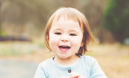 Happy toddler girl playing outside. At sunset Royalty Free Stock Photo