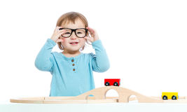 Happy toddler girl playing with trains Stock Photography