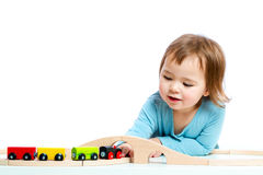 Happy toddler girl playing with trains Royalty Free Stock Image