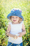Happy toddler girl in rape field Royalty Free Stock Photography
