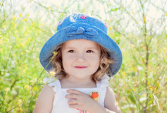 Happy toddler girl in  in rape field Royalty Free Stock Photo