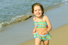 Happy toddler girl running at beach Royalty Free Stock Photography
