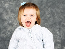 Happy toddler girl studio portrait Royalty Free Stock Images