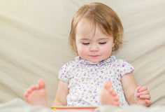 Happy toddler girl using a tablet computer Royalty Free Stock Photo