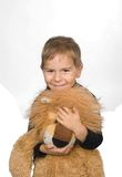 Happy toddler is holding lion toy. Pretty boy is smiling and holding large lion soft toy Stock Images