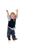 Happy toddler holding up arms. Excited cute blond toddler holds up arms, isolated on white Stock Photo