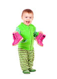 Happy toddler holds shoes Royalty Free Stock Photos